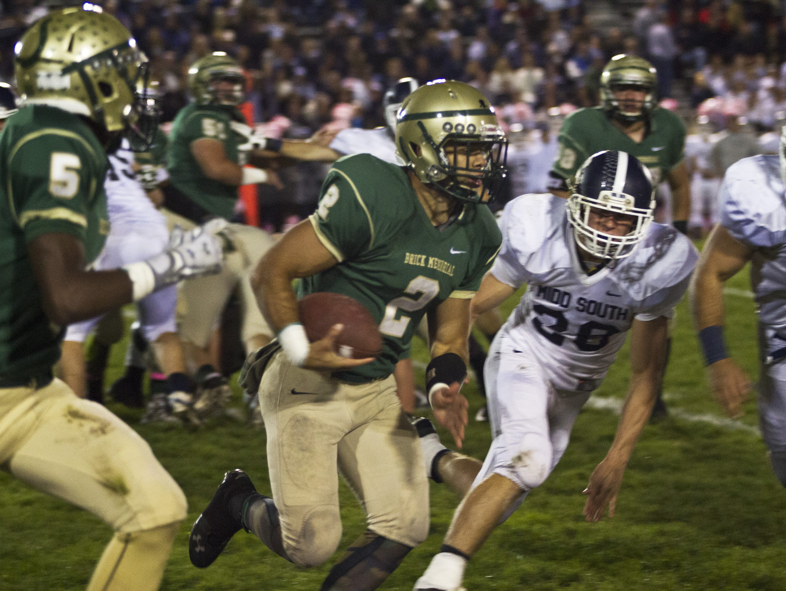 Brick Memorial quarterback Tim Santiago, shown running against Middletown South on Oct. 23, is a key player in Brick Memorial's triple option offense.