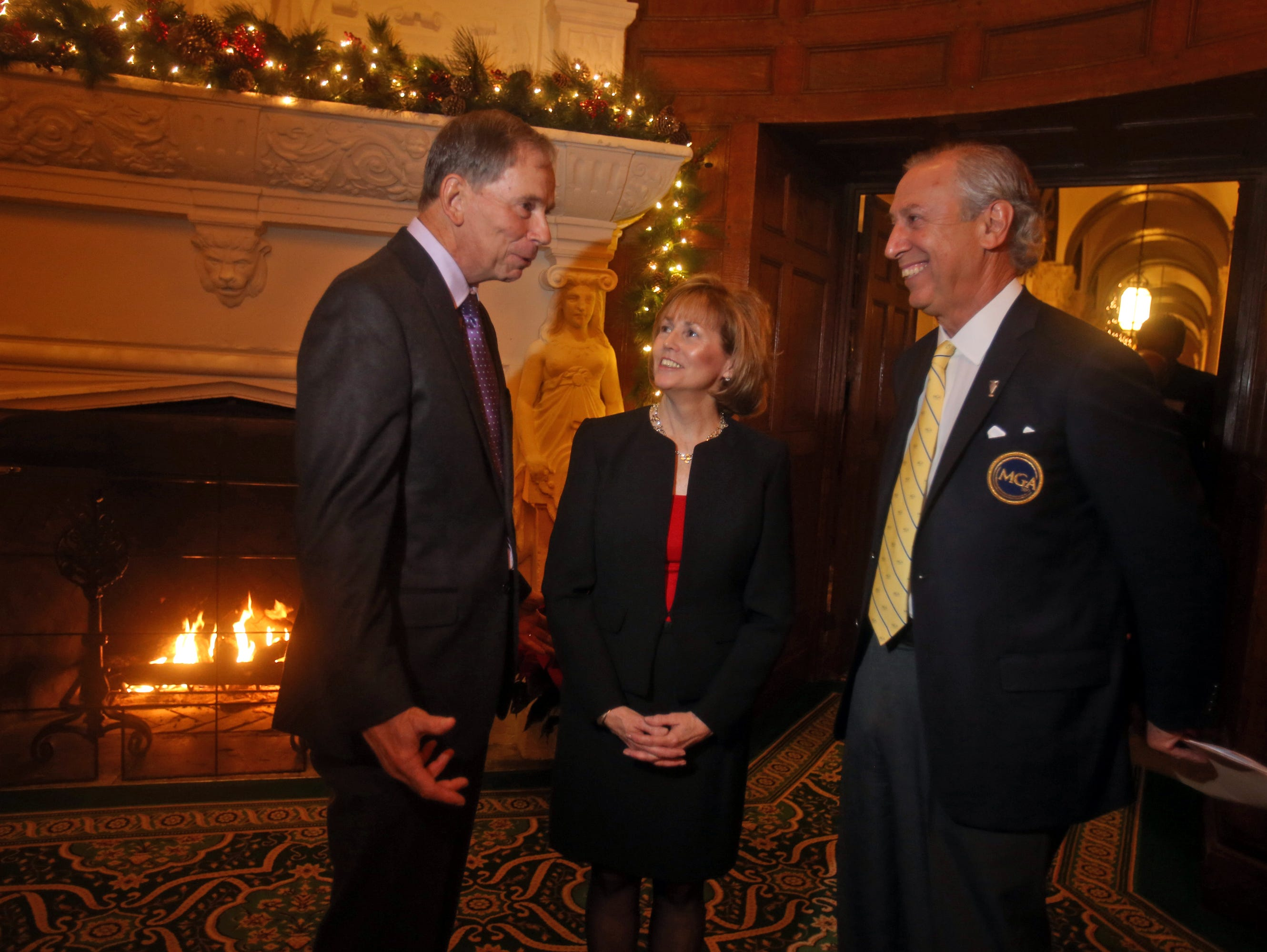 Gene Westmoreland ,left, former MGA championship director; retiring MGA senior communications manager Jeanne McCooey, and executive director Jay Mottola at the MGA's annual meeting held at Westchester Country Club Dec. 2, 2015. McCooey, who has spent 38 years with the MGA, received the organization's Distinguished Service Award.