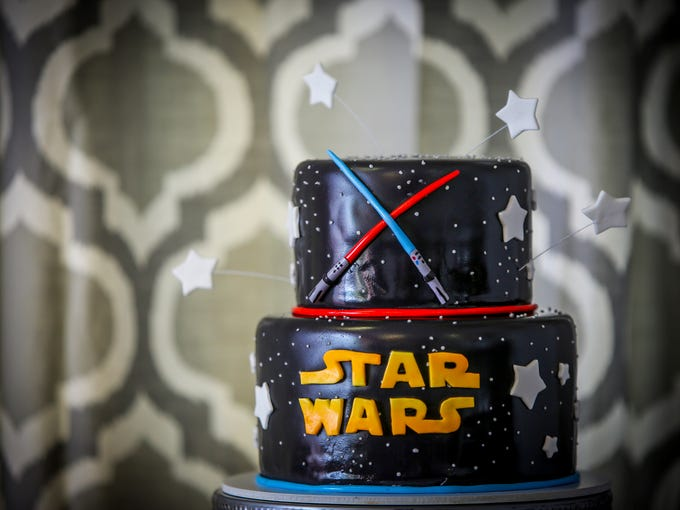 Bess Charles assembled a Star Wars cake at her bakery,