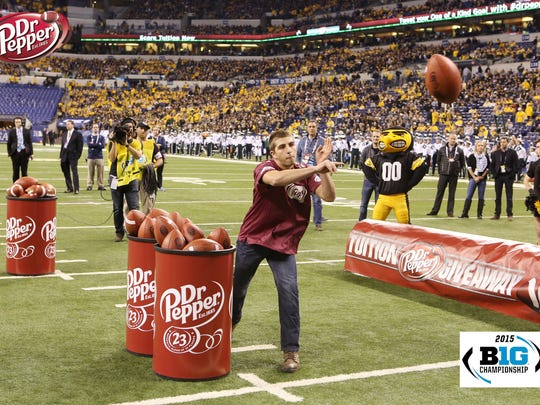 University of Wisconsin-Stevens Point student Alec Cannata competes in the Dr Pepper Tuition Giveaway on Dec. 5, 2015 during the Big Ten championship at Lucas Oil Stadium in Indianapolis.