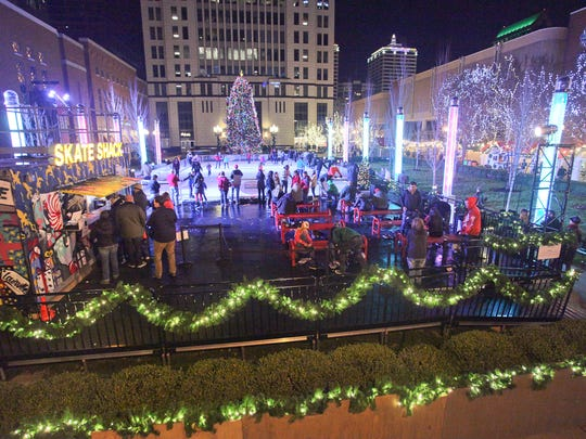 """The ice skating rink is one of the draws at """"Holiday Square"""" in downtown Louisville.  There's also a chance to get your photo with Santa Claus and a Bourbon Village."""