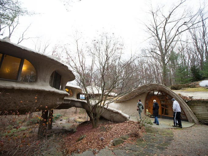 People walk into the mushroom house in Pittsford for