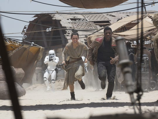 Rey (Daisy Ridley) and Finn (John Boyega) are chased