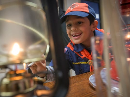 """Cub Scout Ayian Khan, 7, helps """"spread the flame"""" at"""