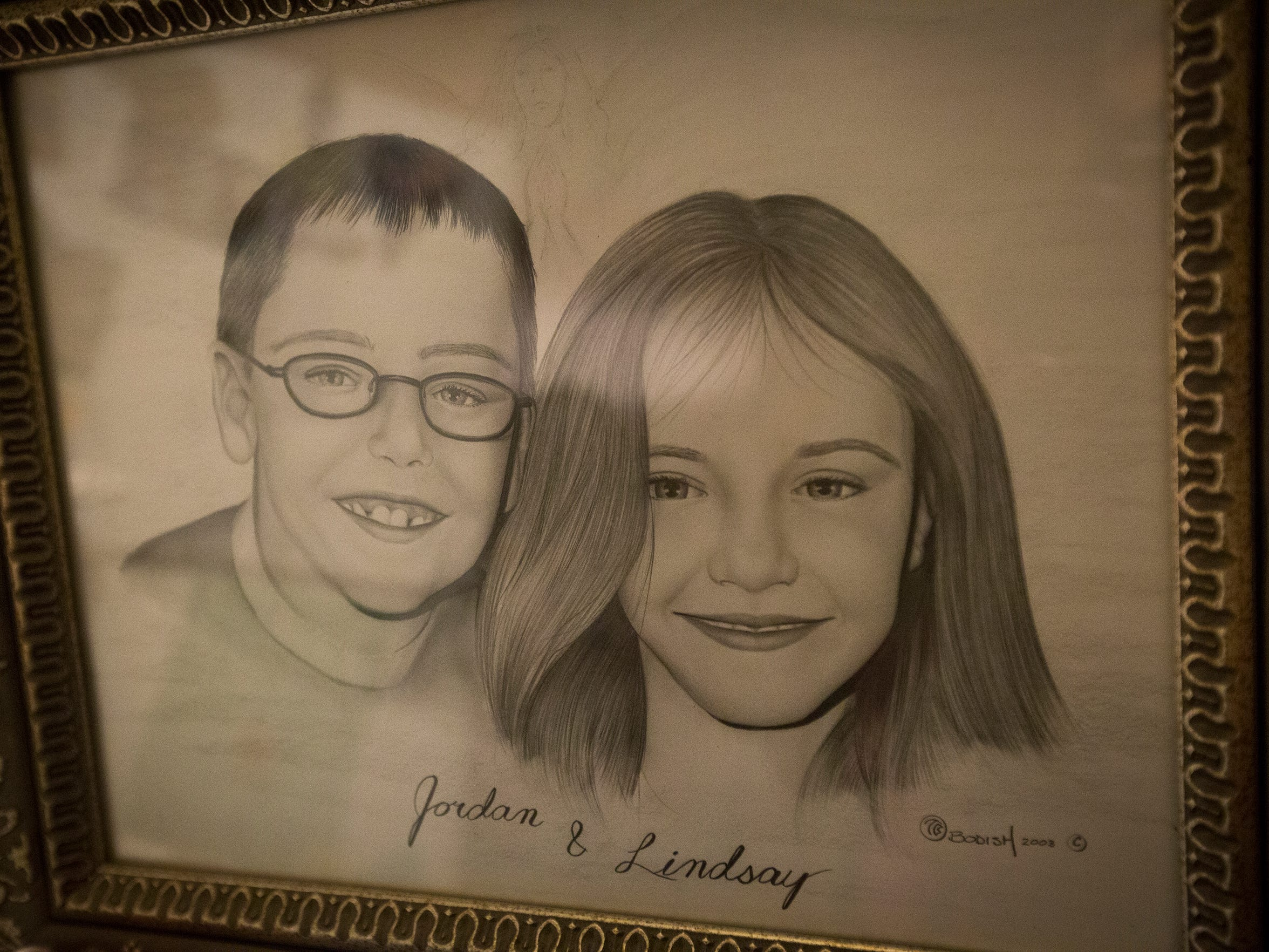 A pencil drawing of the late Jordan and Lindsay Fox at their mother Karen's house in Dubuque, Monday, Dec. 21, 2015. The children were murdered by Karen Fox's estranged husband who also attacked her with a knife. Since her recovery, Fox has found a new faith-filled path and fosters young girls.