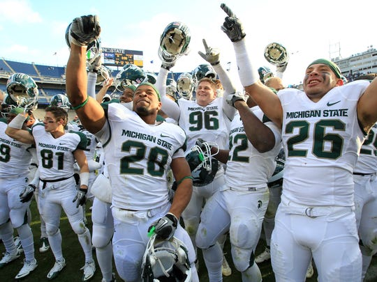 Linebacker Denicos Allen (28) and teammates celebrate MSU's Big Ten championship after beating Penn State on Nov. 27, 2010 in State College, Pa.