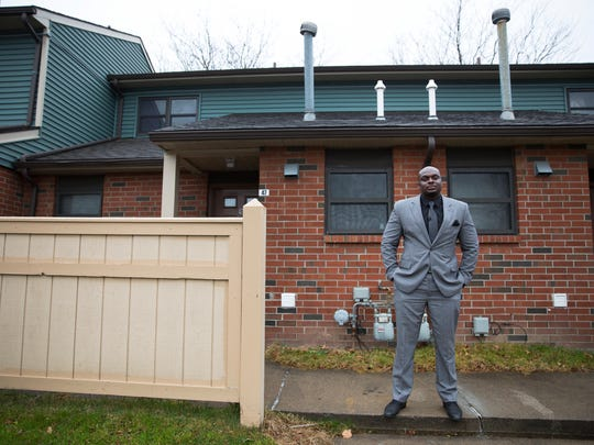 Leonard Brock, director of the Rochester-Monroe Anti-Poverty Initiative, stands in front of the apartment he grew up in on William Warfield Drive.