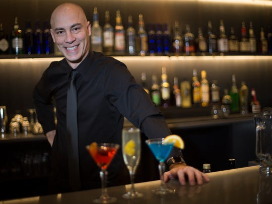 Bartender Clint Curtis makes signature drinks French 75, Negroni and Blue Note at Noce in Des Moines, Tuesday, Dec. 29, 2015.