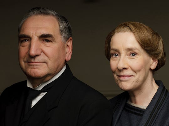 """This photo provided by PBS shows Jim Carter, left, as Mr. Carson and Phyllis Logan as Mrs. Hughes, who star in """"Downton Abbey,"""" which returns Sunday for its sixth and final season."""