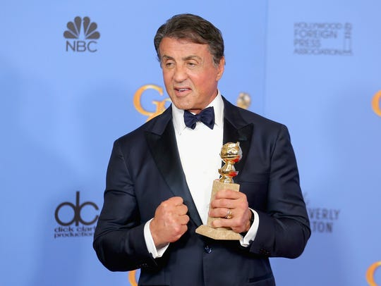 Sylvester Stallone poses with his award for 'Creed'
