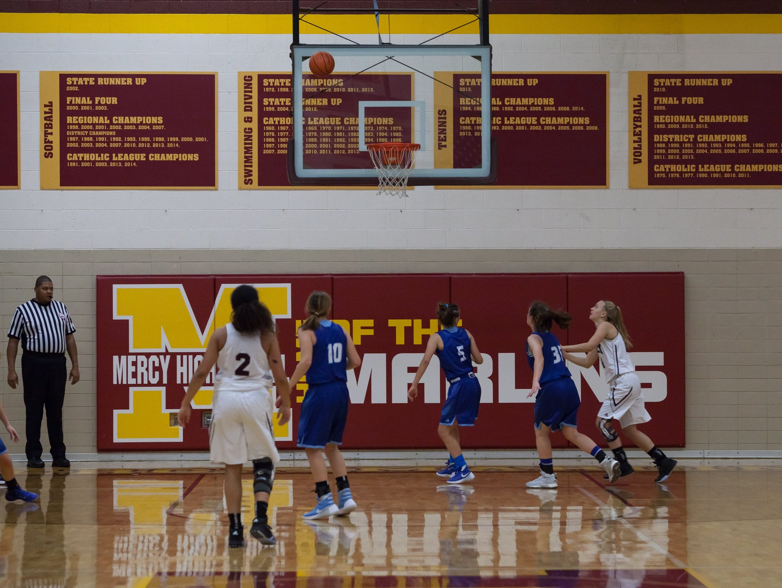 The reunion of the Mercy High School's 1977 and 1982 state championship teams was held during the Marlins Catholic League Central Division opener against Warren Regina at Farmington Hills Mercy on Friday, Jan. 8, 2016.