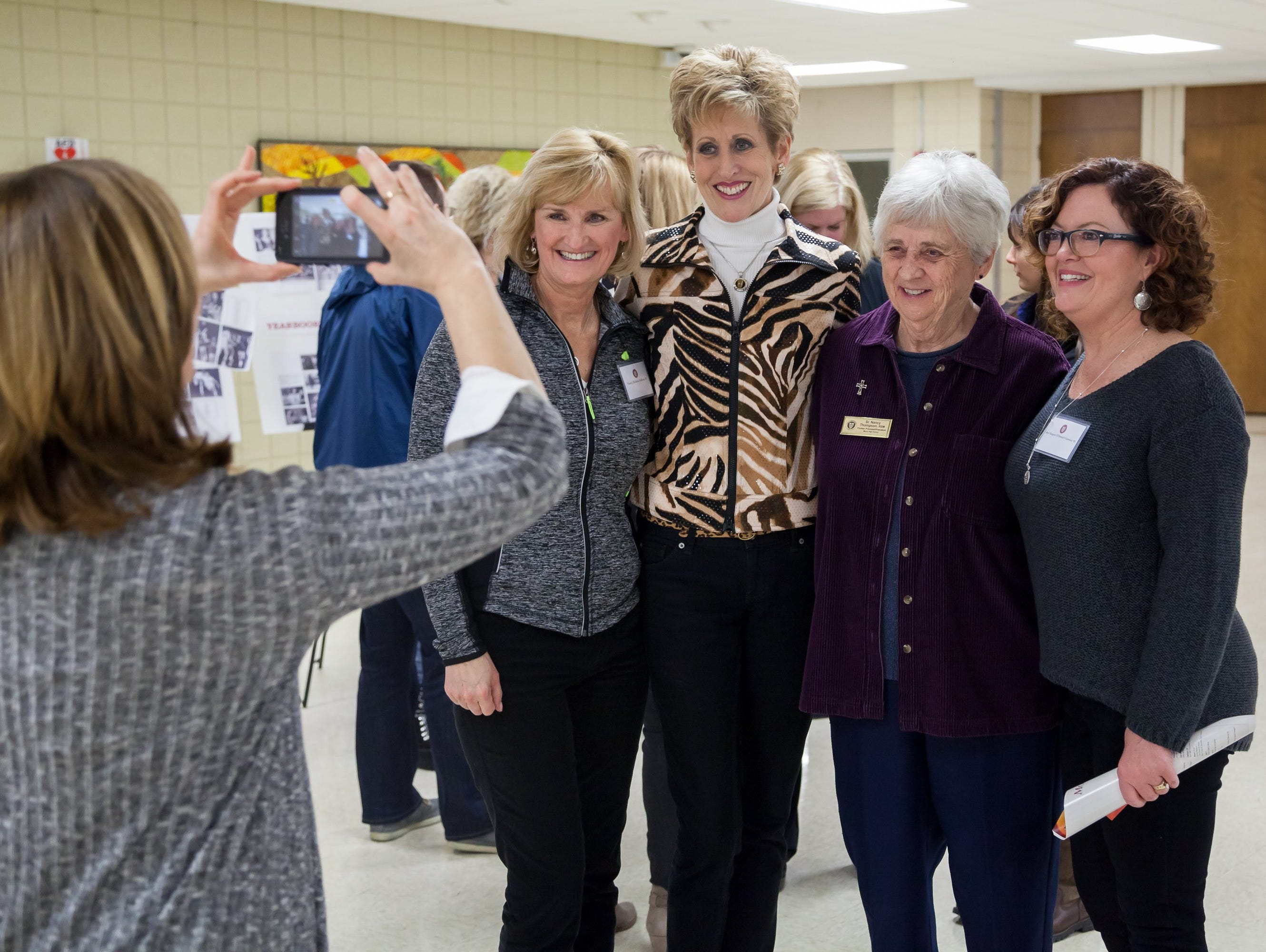 Friends, family and faculty joined in the celebration of Mercy High School's 1977 and 1982 state championship basketball teams at Farmington Hills Mercy on Friday, Jan. 8, 2016.