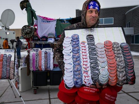 Vendor Chris Micheals sells memorabilia at a Donald Trump campaign stop in Marshalltown at 2:03 p.m. Tuesday, Jan. 26, 2016.