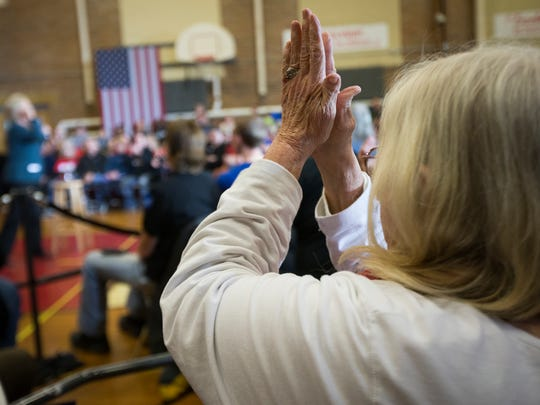 A Hillary Clinton supporter claps as Clinton finally arrives in Marshalltown after she was delayed from Cedar Falls at 10:23 p.m. Tuesday, Jan. 26, 2016. Crowds danced and ate pizza while they waited.