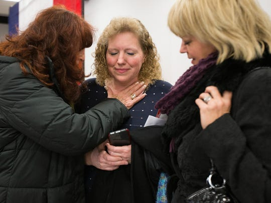 Marilyn Govender, left, Mary Blom and Barbara Heil pray for good health after attending a campaign event for Florida's U.S. Sen. Marco Rubio in Marshalltown at 1:20 p.m. Tuesday, Jan. 26, 2016. Although they are still undecided, they enjoyed hearing Rubio speak so openly about his faith.