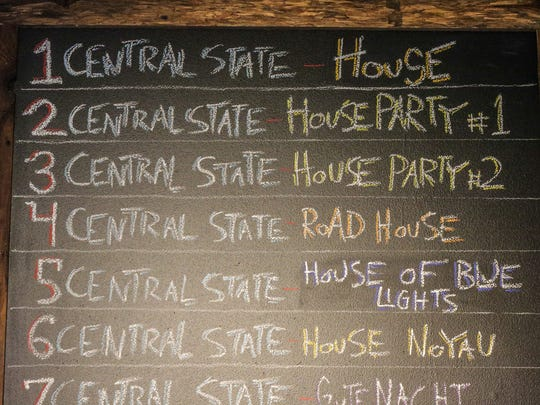 A chalkboard shows off Central State Brewery's  Koelschip Tap Room's beer offerings during the soft opening.