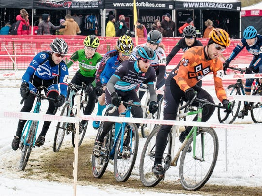 Cyclists compete during the annual Jingle Cross cyclo-cross races in 2014 at the Johnson County Fairgrounds.