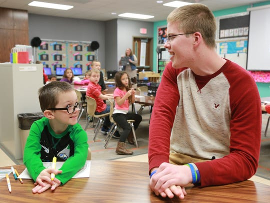 Former Columbus North basketball player Josh Speidel  is volunteering at Brown Elementary in Seymour.