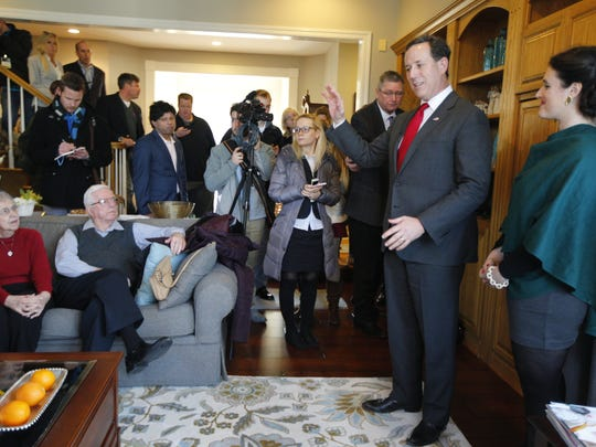 Rick Santorum, second from right, appears at a house party attended by about 60 people at the home of Rene and Mary Beth Beacom in West Des Moines on Sunday, Jan. 31, 2016.  His daughter, Elizabeth, 24, stands to his right.