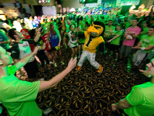 Herky impresses the crowd with his dance moves during