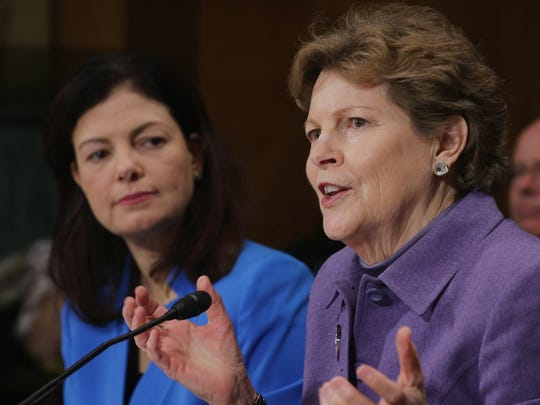 Sens. Kelly Ayotte, R-N.H., left, and Jeanne Shaheen,