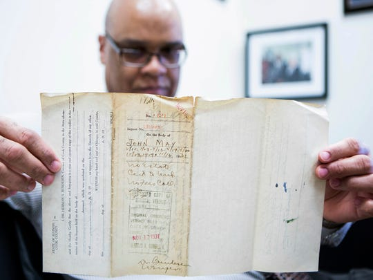 James Sledge, an executive officer at the Cook County Medical Examiner's office in Chicago, holds one of the original autopsy reports from the infamous Valentine's Day massacre 87 years ago.