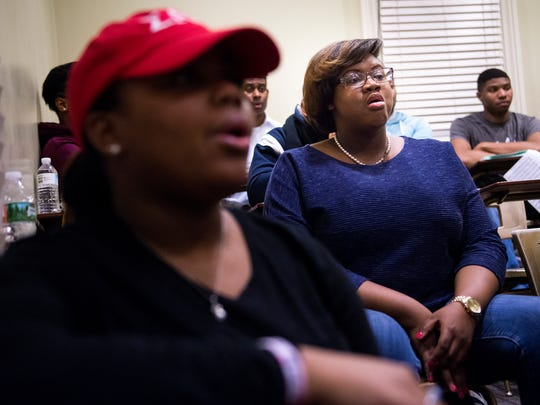 Brianna Barbour, right, sings during rehearsal with the Fisk Jubilee singers at Fisk University, Tuesday, Feb. 23, 2016, in Nashville, Tenn. Complications from Barbour's cancer treatments resulted in her having to relearn how to sing.