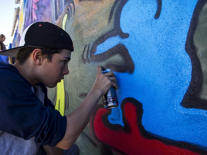 Quade Miller-Edwards, 14, adds finishing touches to