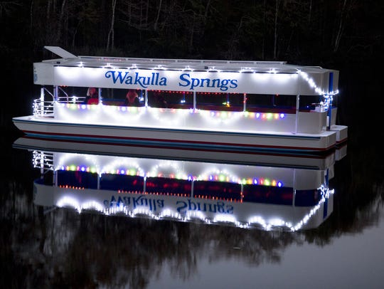 "The Wakulla Springs boat, dubbed ""Henry,"" is decked out for a New Year's Eve expedition."