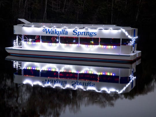 """The Wakulla Springs boat, dubbed """"Henry,"""" is decked out for a New Year's Eve expedition."""