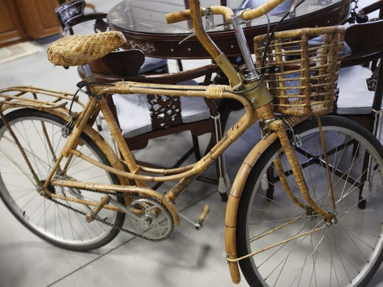 A vintage rattan and bamboo wrapped bicycle.