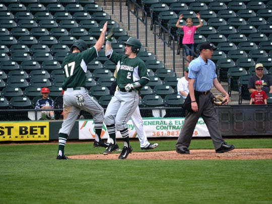 Freshman third baseman Marty Mechina (2) and outfielder Kris Simonton (17) celebrate a run at last weekend's Kleberg Bank Tournament in Corpus Christi, Texas. The Spartans (6-0) are part of this weekend's Cox Diamond Invitational at Blue Wahoos Stadium.