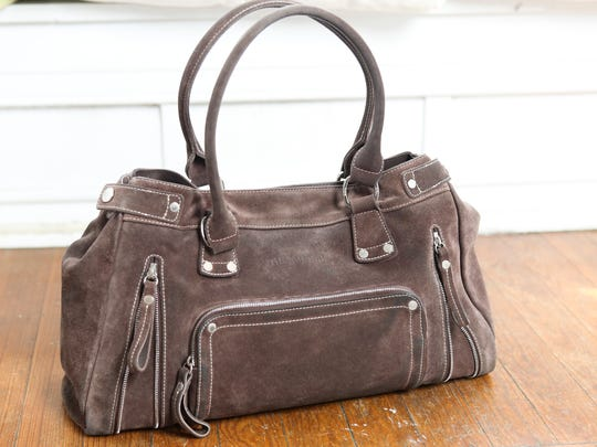 This brown leather Longchamp bag is Susan Howe's go-to. March 7, 2016