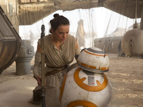 Rey (Daisy Ridley) and BB-8 are in a scene from 'Star