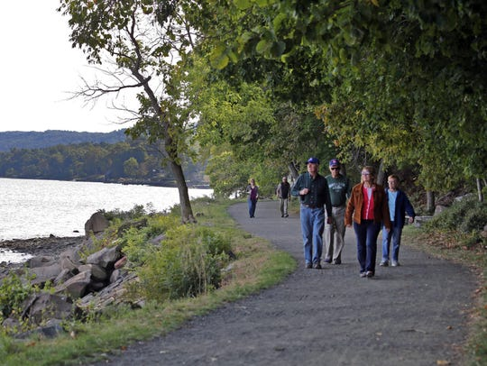 People walk along the Hook Mountain/Nyack Beach State