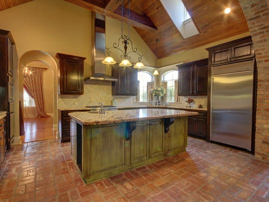 The gourmet kitchen features top of the line appliances and finishes.