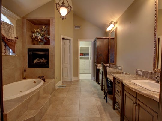 The gorgeous master bath has ample closet space.