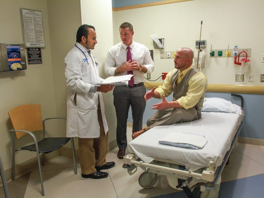 (Left to right) Dr. Vikram Varma, chairman of emergency medicine at Community Medical Center in Toms River, speaks with John Brogan and Tom Altieri, both addiction recovery specialists, in a 2015 file photo.