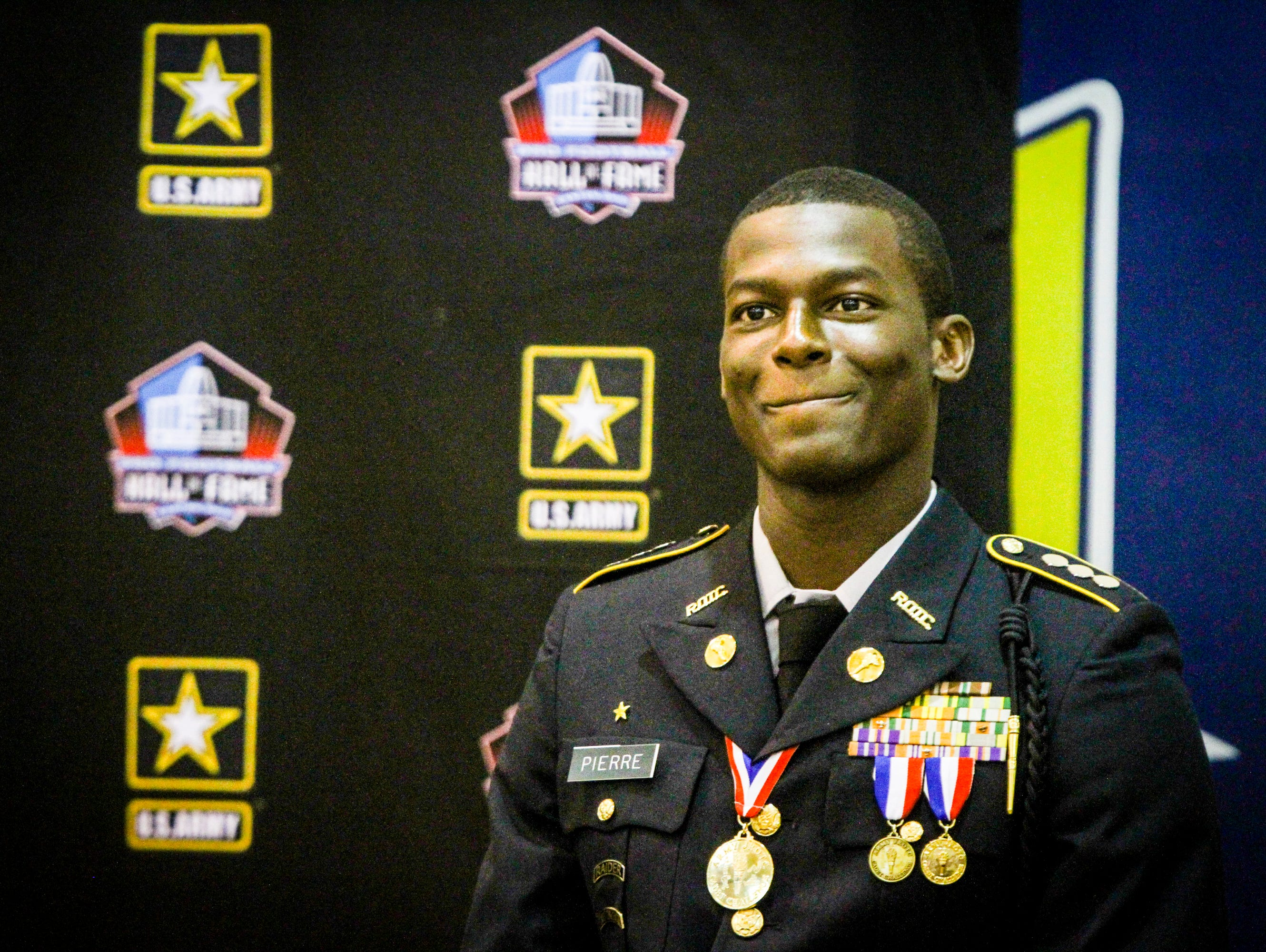 Lehigh Senior High senior Wadley Pierre was nominated as a finalist for the US Army and Pro Football Hall of Fame as a student-athlete finalist for an award of excellence. Hall of Fame NFL player Kevin Greene was there to present the recognition.