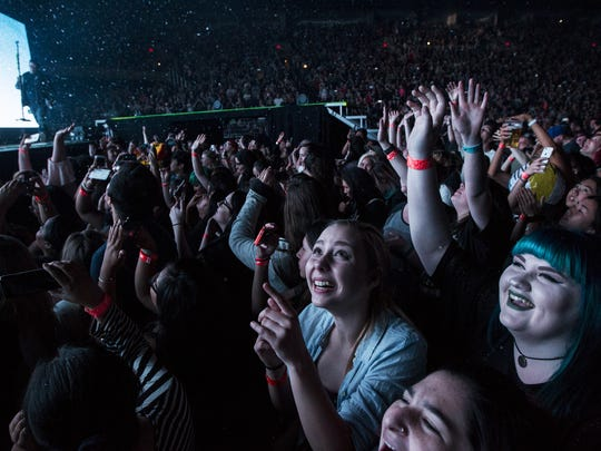 Fans cheer before Fall Out Boy perform on Friday, Mar.