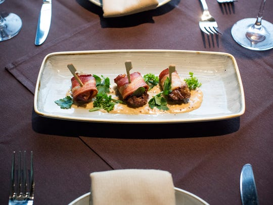 Rumaki: Chicken liver, apples and sage wrapped in bacon, finished with a brandy and whole grain mustard cream sauce at La Chasse on Bardstown Road.