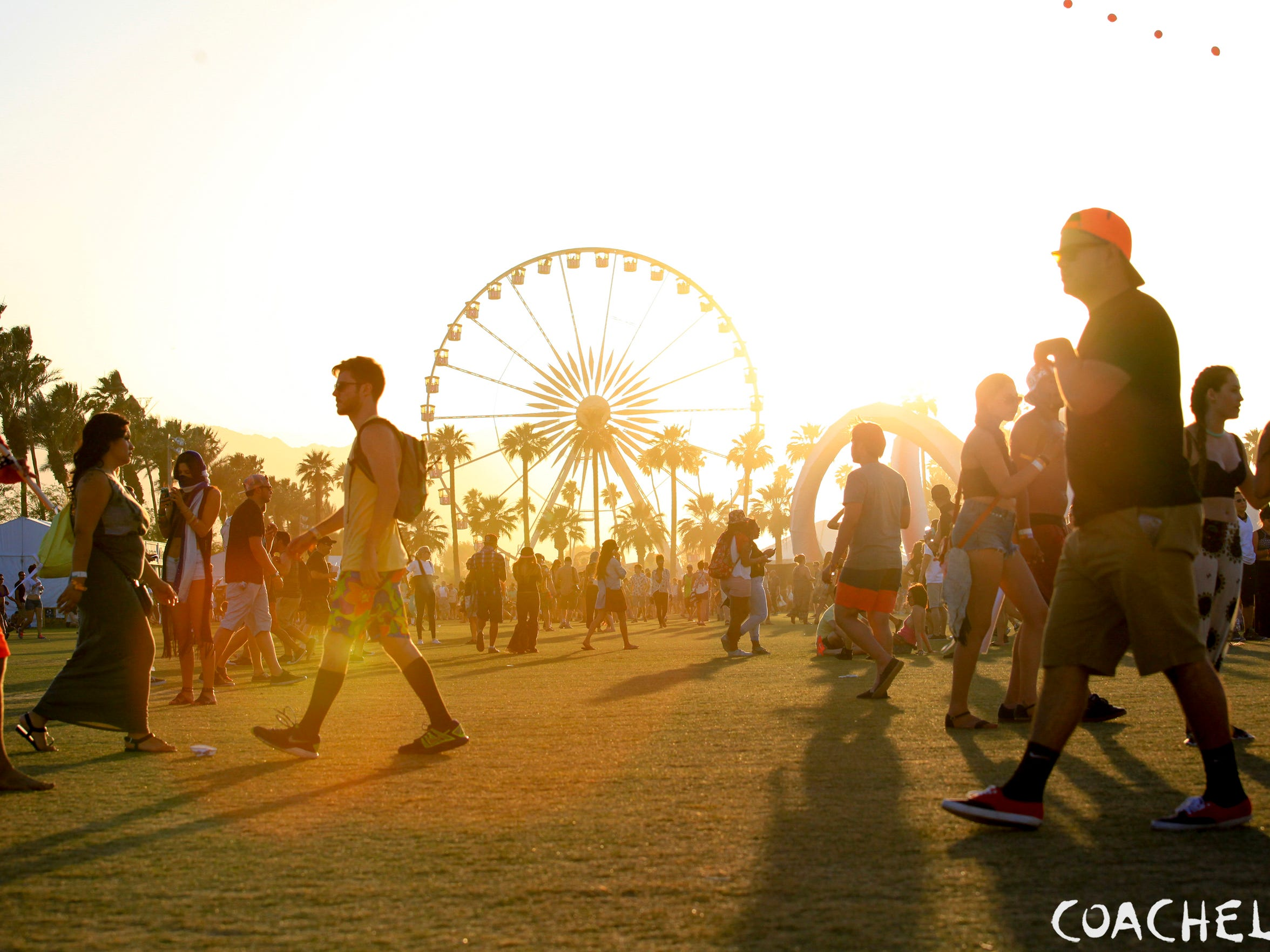 Crowds walk the grounds at Coachella.