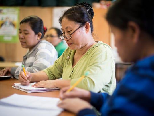 Bu Lah Aung, center, during an English class at the