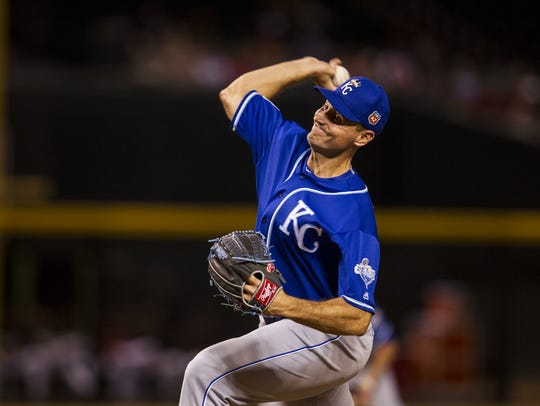 Kansas City Royals' Chris Young throws against the