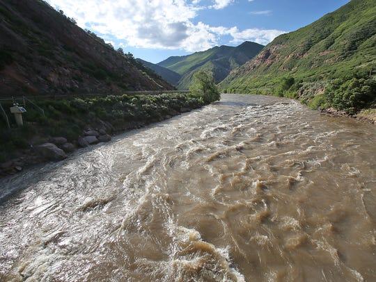 The Colorado River flows through the mountains near