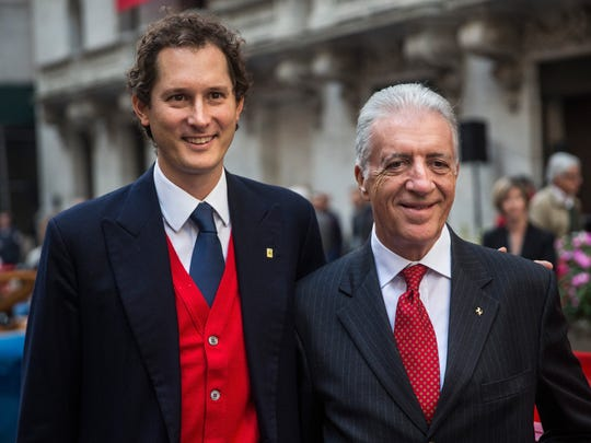 John Elkann (L), Chairman of Fiat Chrysler Automobiles and CEO of Exor, and Piero Ferrari, son of Ferrari Automotive Company founder Enzo Ferrari and Vice Chairman of the company, pose with a Ferrari outside the New York Stock Exchange after Ferrari's IPO on Oct. 21, 2015, in New York City.