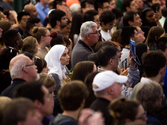 People listen as former president Bill Clinton speaks during a rally for his wife Hillary, a Democratic presidential hopeful, at Binghamton University on Saturday, April 16, 2016.