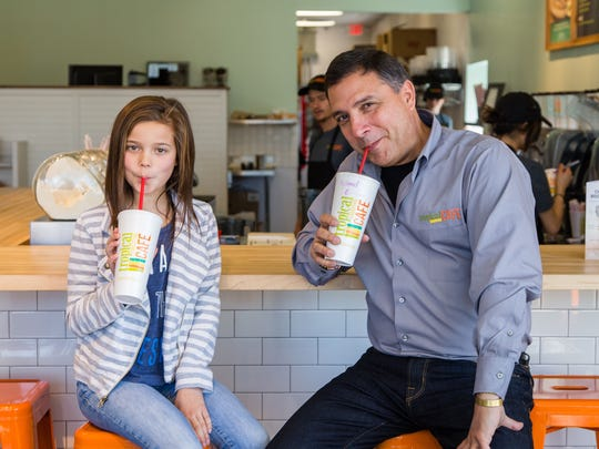 Tropical Smoothie Cafe CEO Mike Rotondo and 10 year old Emma Merkel enjoy a smoothie at the Tropical Smoothie Cafe located at 4400 Lake Michigan Dr., Walker, Michigan on March 11, 2016.