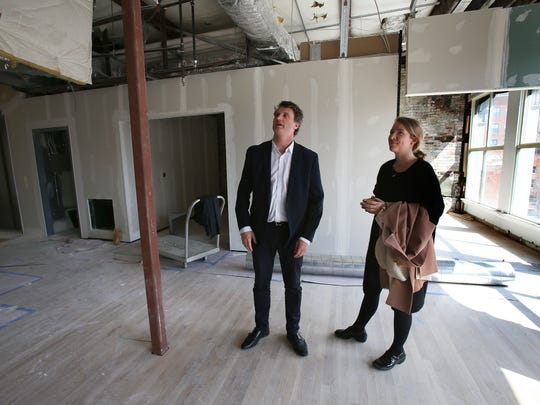 Aldy Milliken, left, executive director of the Kentucky Museum of Art and Craft, talks with KMAC communications manager Emily Miles as they look over the space under construction.  They plan to open the newly renovated facility soon.Mar. 28, 2016
