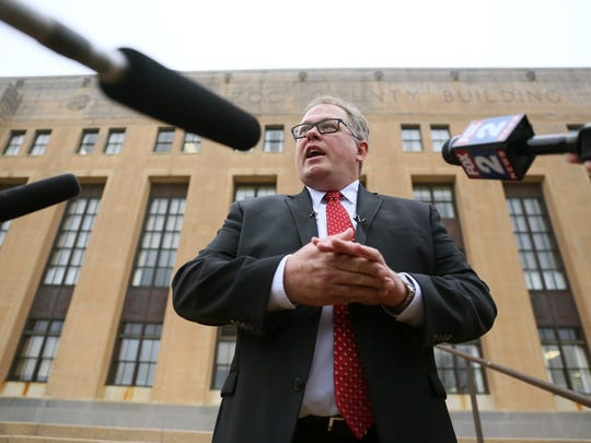 Kalamazoo County Prosecuting Attorney Jeff Getting talks to reporters outside the county courthouse after a hearing for suspected mass murderer Jason Dalton, who was found mentally competent to stand trial Friday.